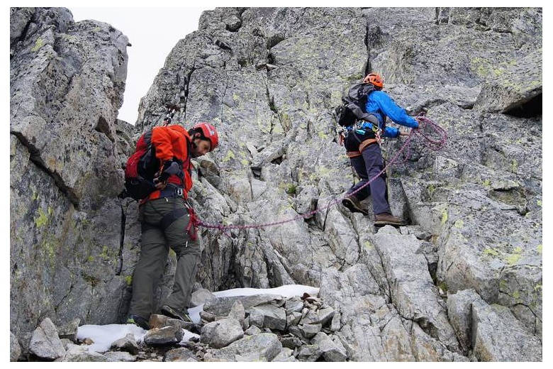 alpinists in progression roped off together to protect the fall of the student