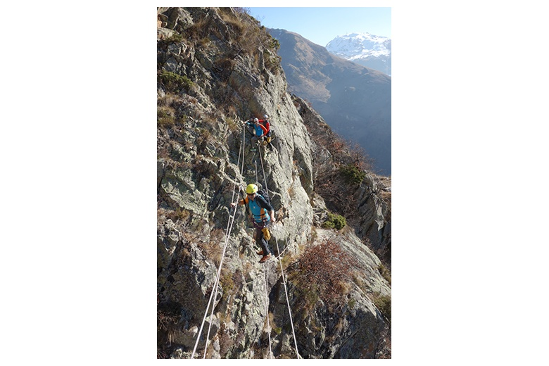 group of via ferrata passionates on a tibetan bridge in the poi d'unha via ferrata on a splendid day