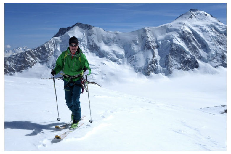 tour skier progressing along the oberland glacier