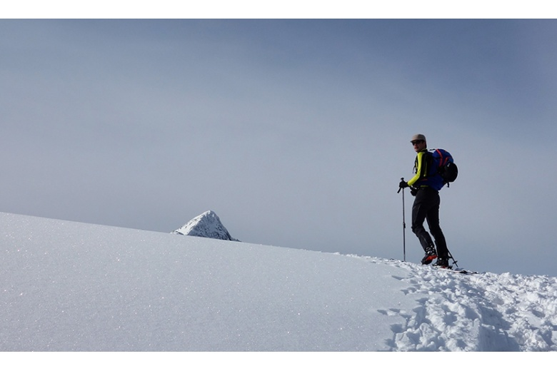 top of the montardo on image from the salana with skier on his way to the summit