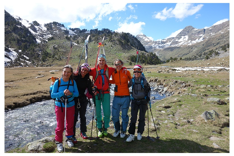 big smiles of touring skiers at the plan de aigüalluts after a long day going up to the Aneto summit and then down