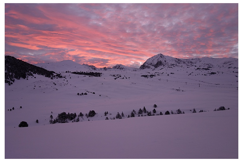 beautiful image of the beret area of the Baqueira-Beret ski resort at sunrise with the tuc de beret far left