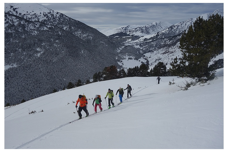 group of skiers in the serra de bandolers heading to the tuc de barlonguèra, beautiful view of valle del noguera pallaresa and montgarri