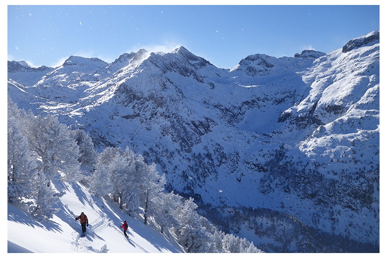 mountain skiers progressing towards the tuc de salana summit, beauiful view of ribera de loseron