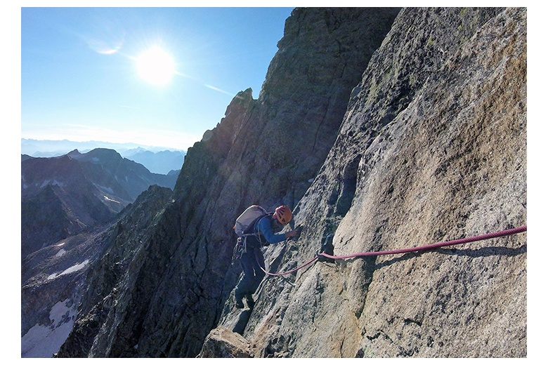 climber in the salenques ridge performing a traverse on his way to the aneto summit