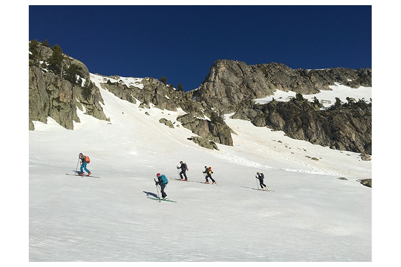group ascending the garmo negro close to the ibones de arnales