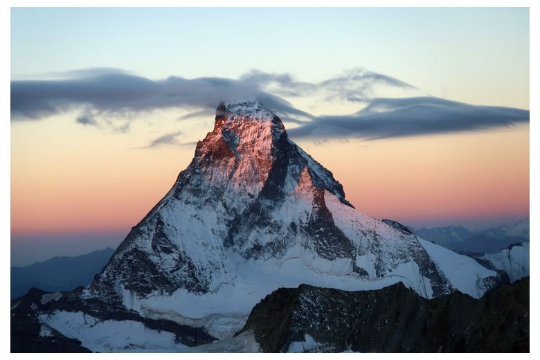 view of the north face of the matterhorn, orange sky on sunset
