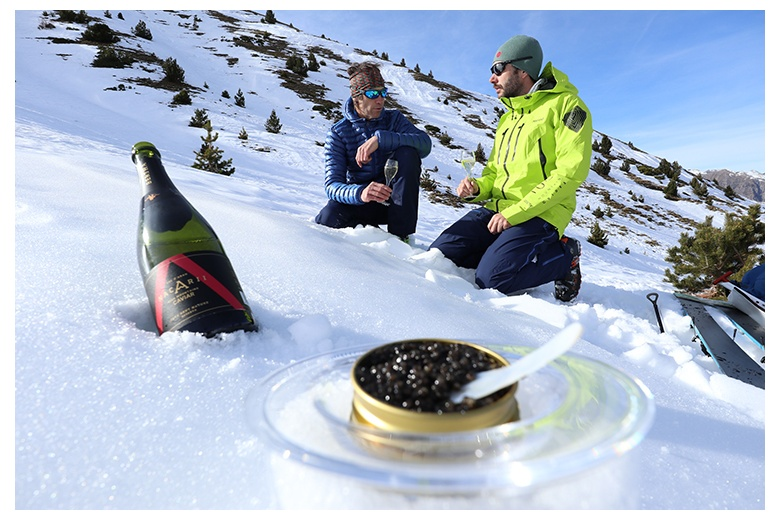 relaxed atmosphere around the nacarii sparkling white wine and caviar in the middle of the mountains