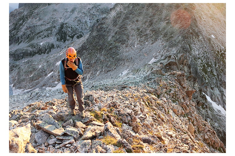 mountain climber at the beginning of the route to the aneto's summit via the salenques-tempestades ridge