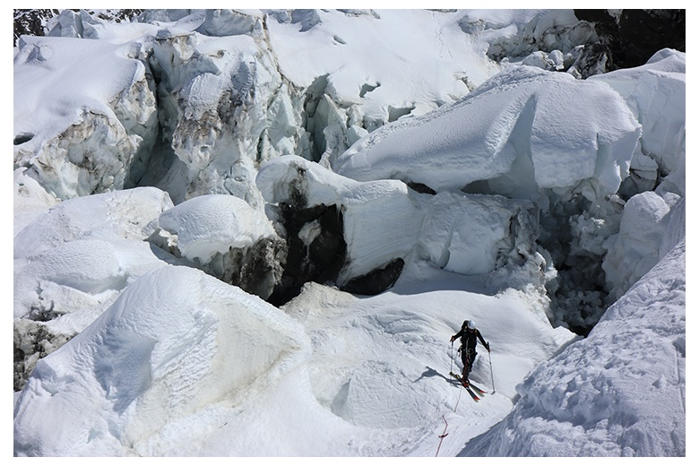 ski mountaineer surounded by huge crevices during the ascent to the highest peak in the Alps, the Mont Blanc