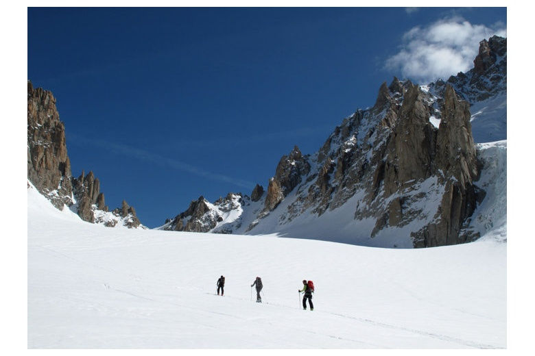 group climbing towards the Chardonnet pass between the chardonnet spire and argentiere