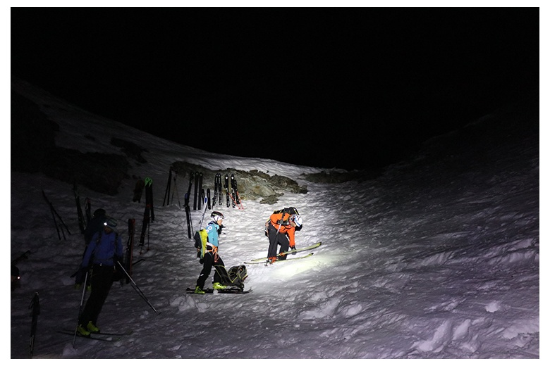 ski mountain climbers at dark getting ready before leaving the grands mulets hut towards the mont blanc summit