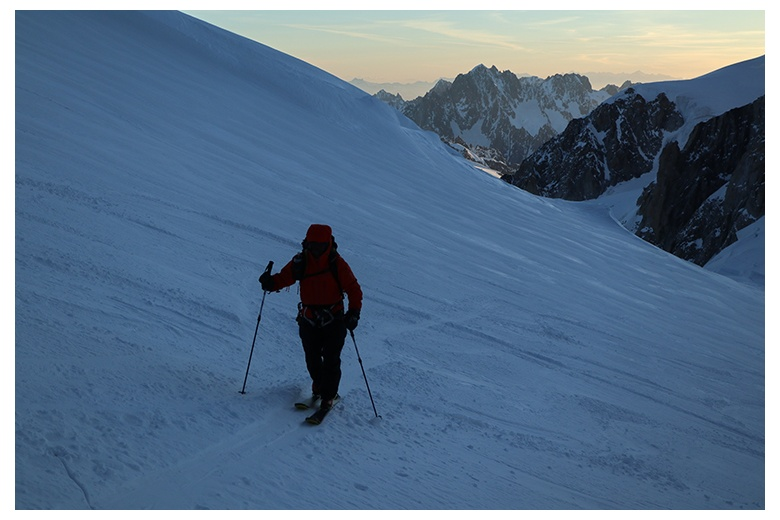 ski climber on a slope of the mont blanc ascending to the summit at sunrise