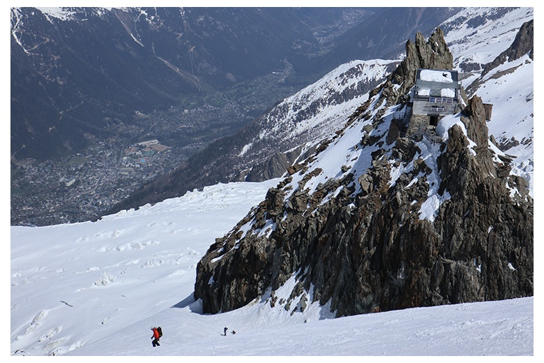 beautiful picture while descending the mont blanc with chamonix at the back and grands mulets hut