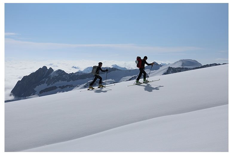 touring skiers ascending the aneto on a superb sunny day, fantastic view of the Forcanada