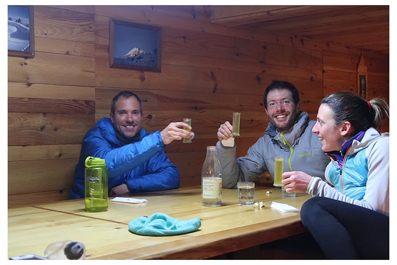 group of people having a drink inside saboredo hut