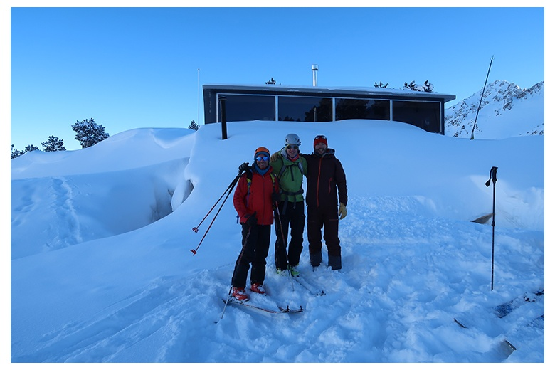 group of skiers outside saboredo hut right before starting the route of the day