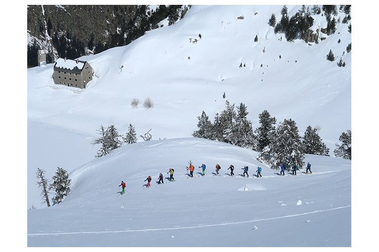 touring skiers on their way up valarties leavin the ventosa i calvell hut behind