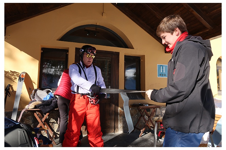 touring skiers getting ready for the day outside hotel banhs de tredòs