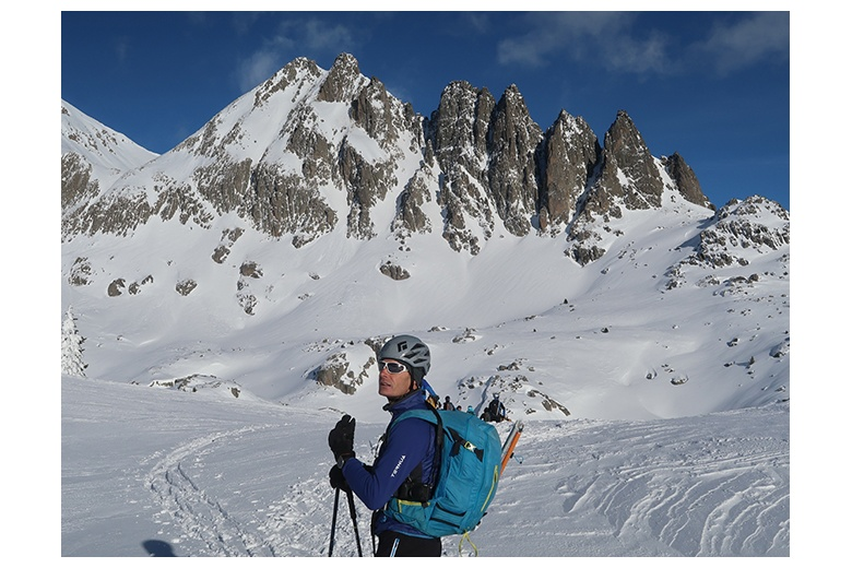 group of ski tourers getting close to refugi joan ventosa i calvell with amazing view to agulles de travessany