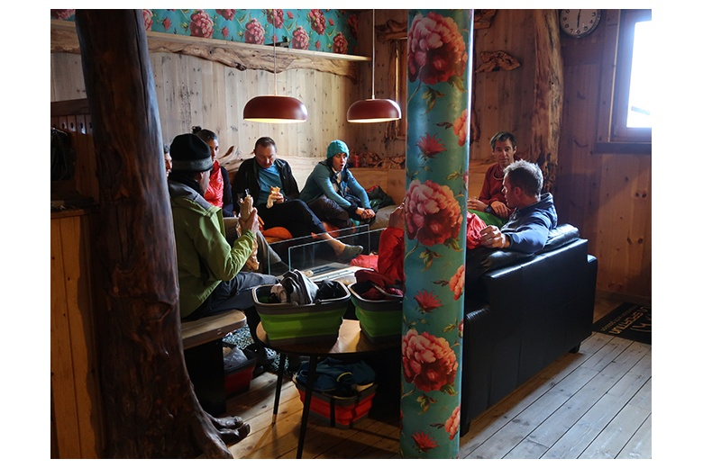 group of people recovering and resting at ventosa i calvell hut