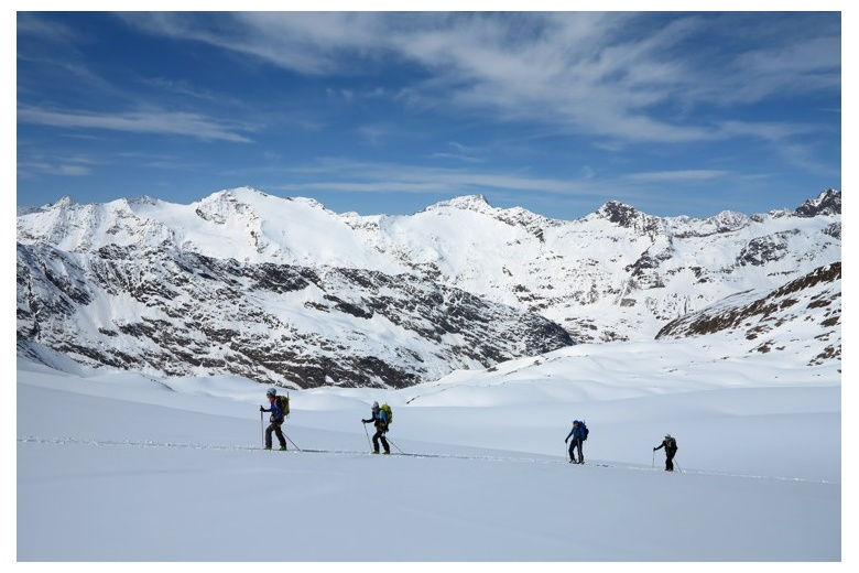 skiers crossing the glacier