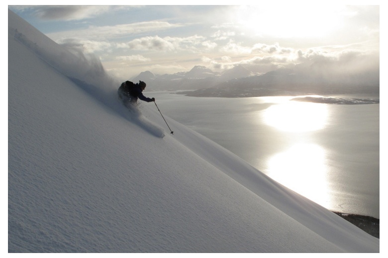 skiing down on powder snow in Norway