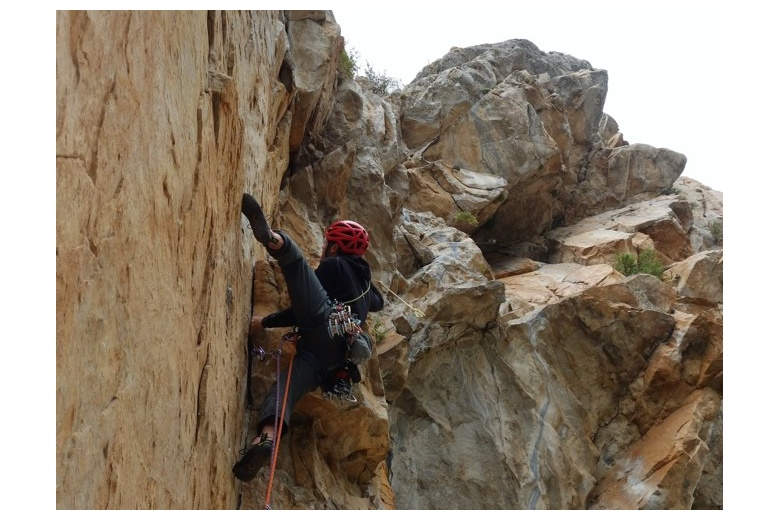 climber showing beautiful technique to overcome difficulties at peña montañesa
