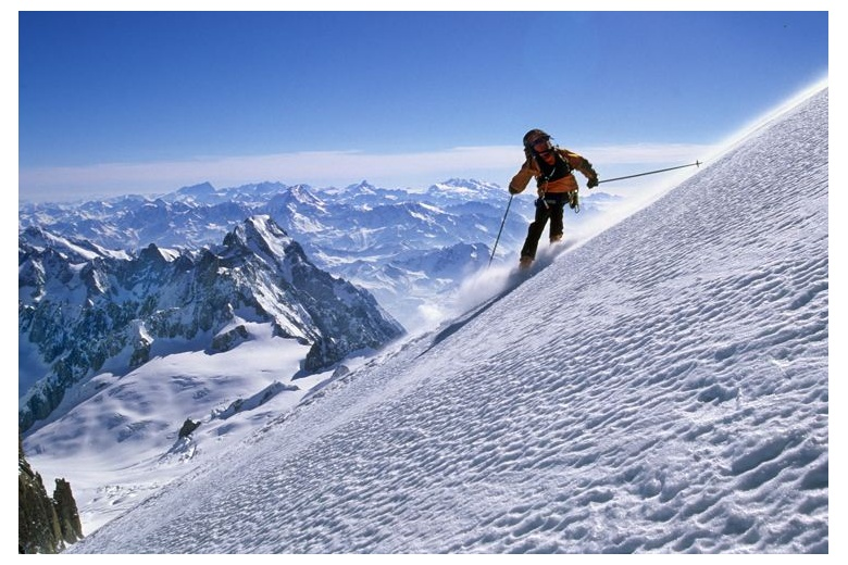 skier descending the Mont Blanc with magnificient view on the background