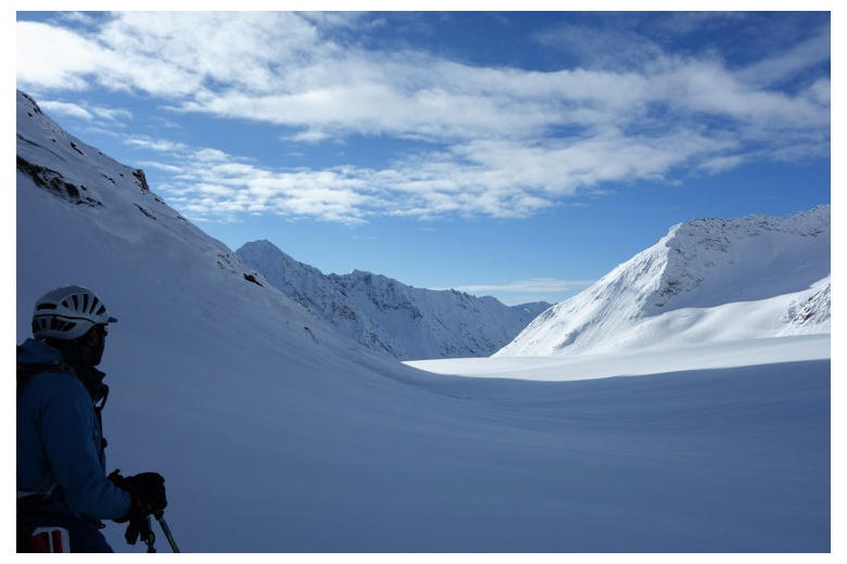 person observing the fieschergletscher glacier below the finsteraarhornhutte