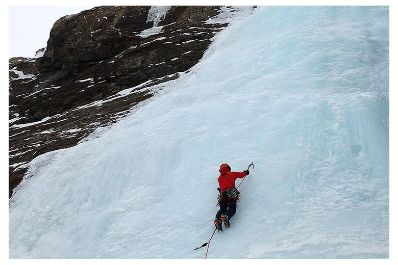 ice climbing an ice wall on the north face of gavarnie in the pyrenees
